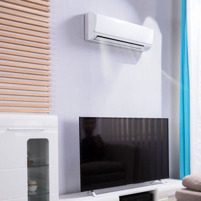 wall mounted ac blowing air above a tv in living room