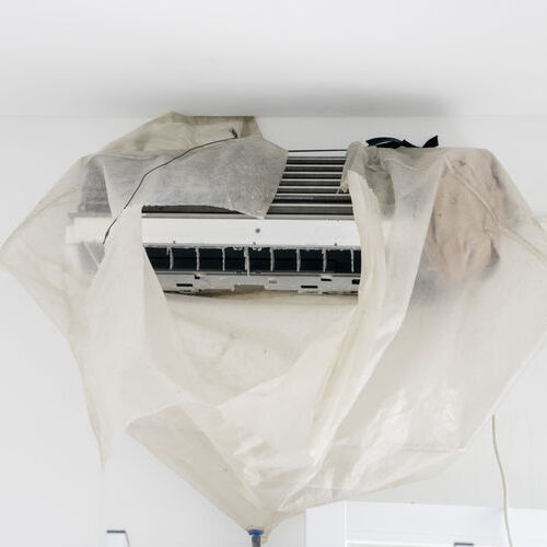 a dirty blower fan wrapped for repairs